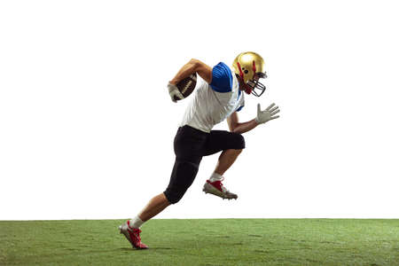 In jump, flight. American football player isolated on white studio background with copyspace. Professional sportsman during game playing in action and motion. Concept of sport, movement, achievements.