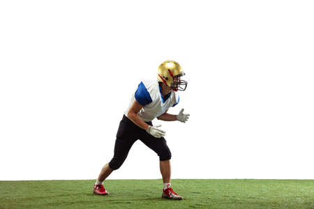 In action. American football player isolated on white studio background with copyspace. Professional sportsman during game playing in action and motion. Concept of sport, movement, achievements.