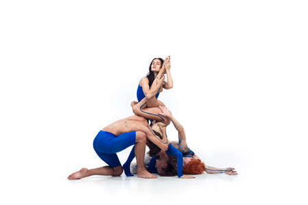 Line. Group of modern dancers, art contemp dance, blue and white combination of emotions. Flexibility and grace in motion and action on white studio background. Fashion and beauty, artwork concept.