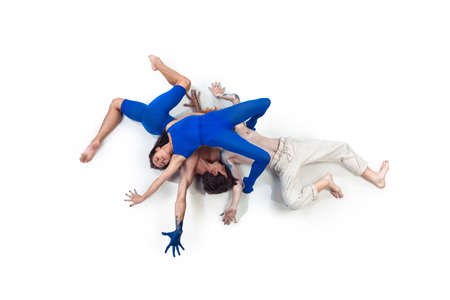 Sky. Group of modern dancers, art contemp dance, blue and white combination of emotions. Flexibility and grace in motion and action on white studio background. Fashion and beauty, artwork concept.