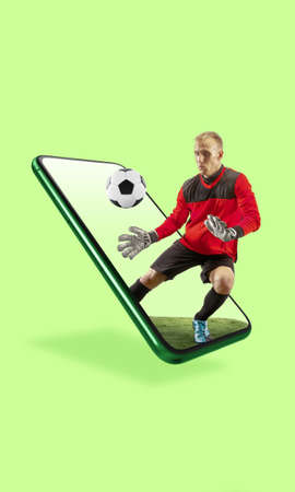 Your smartphone or other device - all you need for modern lifestyle. Copyspace for ad. Shopping, deliverying goods, online shopping and services concept. Football player in jump, stream of match.