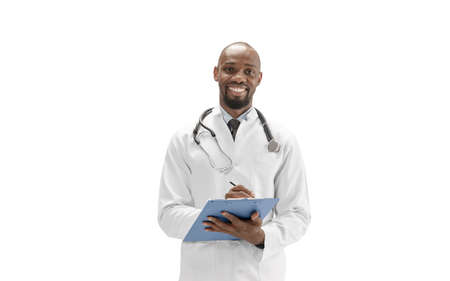 Paperwork. African-american doctor isolated on white background, professional occupation. Daily hard work for health and lives saving. Half-length portrait. Medicine, healthcare, profession concept.