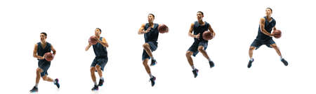 High flight. Young basketball player of team training in action, motion in jump of step-to-step goal isolated on white background. Concept of sport, movement, energy and dynamic, healthy lifestyle.