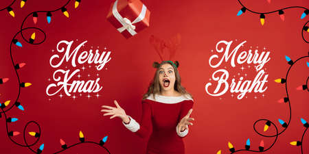 Greeting flyer for ad. Concept of Christmas, 2021 New Years, winter mood, holidays. Copyspace, postcard. Beautiful caucasian woman like Santas Rudolph the Red-Nosed Reindeer catching giftbox.