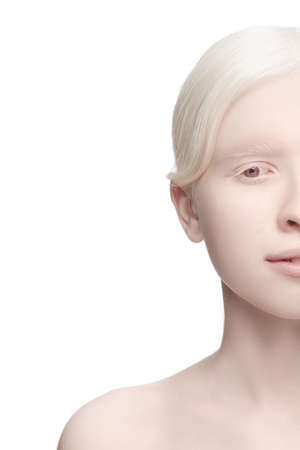 Calm, tender. Portrait of beautiful albino woman isolated on white studio background. Beauty, fashion, skincare, cosmetics concept. Copyspace. Well-kept skin, fresh look. Inclusion and diversity.