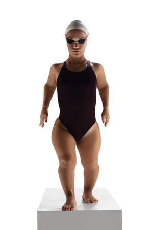 Athlete. Beautiful dwarf woman practicing in swimming isolated on white background. Lifestyle of inclusive people, diversity and equility. Sport, activity and movement. Copyspace for ad.