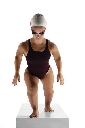 Professional. Beautiful dwarf woman practicing in swimming isolated on white background. Lifestyle of inclusive people, diversity and equility. Sport, activity and movement. Copyspace for ad. Stock Photo