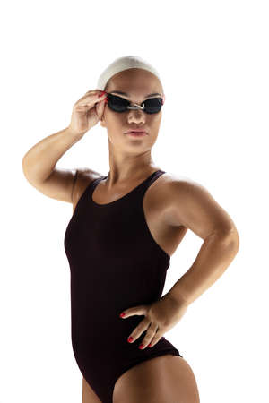 Confidence. Beautiful dwarf woman practicing in swimming isolated on white background. Lifestyle of inclusive people, diversity and equility. Sport, activity and movement. Copyspace for ad.