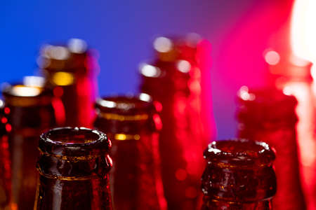 Navy. Neon colored beer bottles, close up isolated on bright studio background. Concept of beer, beverage, entertainment and alcohol. Copyspace for your bar, restaurant, brewery or shop advertising.