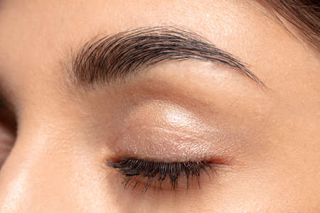 Eyelid, brow. Close up portrait of beautiful jewish female model. Parts of face and body. Beauty, fashion, skincare, cosmetics, wellness concept. Well-kept skin aesthetic, fresh look, details. Standard-Bild