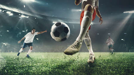 Exciting moment. Young male soccer or football players attacking at the stadium in flashlights, spotlights. Concept of professional sport, competition, team play, hobby, motion, movement. 3D render.