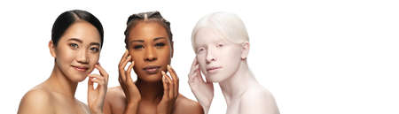 Close-up portrait of different ethnicity and beautiful young women isolated on white background. Flyer for ad. Concept of beauty, fashion, healthcare, skincare. Interracial and multiculturalism.