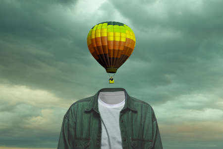 Sky. Male body of model with black air ballon instead head isolated on blue grey background. Trendy colours and modern design. Contemporary art collage. Inspiration, mood, creativity, brain concept