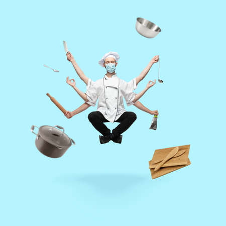 Safety. Handsome cooker, chef multi-armed baker levitating isolated on blue studio background with equipment. Concept of professional occupation, work, job, cooking, cuisine. Multi-task like Shiva.