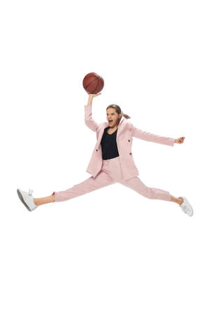 Basketball. Happy young woman dancing in casual clothes or suit, remaking legendary moves and dances of celebrity from culture history. Isolated. Action, motion, fame concept. Creative occupation.