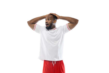 Astonished, shocked. Funny emotions of professional football, soccer player isolated on white studio background. Excitement in game, human emotions, facial expression and passion with sport concept.