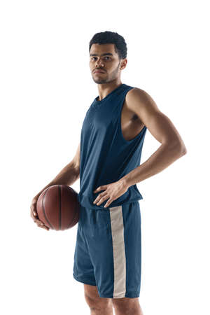Unstoppable. Young arabian muscular basketball player posing confident isolated on white background. Concept of sport, movement, energy and dynamic, healthy lifestyle. Training, practicing.