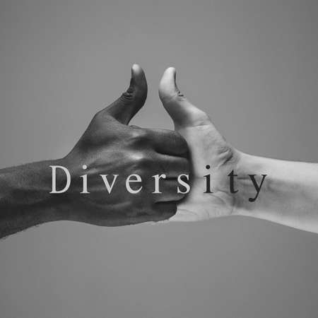 Diversity. African and caucasian hands gesturing on gray studio background. Tolerance and equality, unity, support, kindly coexistence together concept. Worldwide multiracial community.