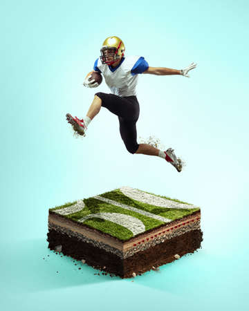 Flying. American football player on blue background above stadium layers. Professional sportsman during game playing in action and motion. Concept of sport, movement, achievements, leadership.