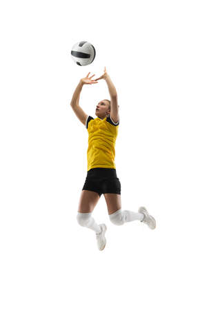 In jump. Young female volleyball player isolated on white studio background. Woman in sportswear training and practicing in action, flight. Concept of sport, healthy lifestyle, motion and movement.
