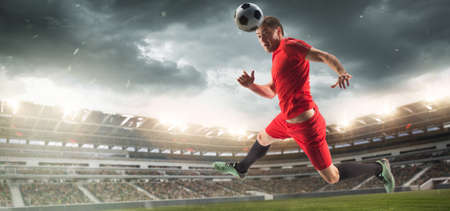 Male football or soccer player at stadium in flashlight. Young male sportive model training. Moment of attacking, catching. Concept of sport, competition, winning, action, motion, overcoming. Flyer.