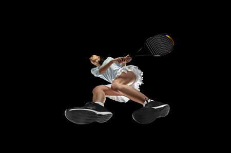 Look. Female professional tennis player in action, motion isolated on black background, look from the bottom. Concept of sport, movement, energy and dynamic, healthy lifestyle. Training, practicing.