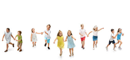 Group of happy school kids or pupils running in colorful casual clothes on white studio background. Creative collage. Banque d'images