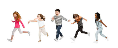 Art collage made of portraits of little and happy kids isolated on white studio background. Human emotions, facial expression concept