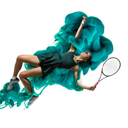 Young girl tennis player in explosion of colored neon green smoke fluid isolated on white background. Levitation Banque d'images