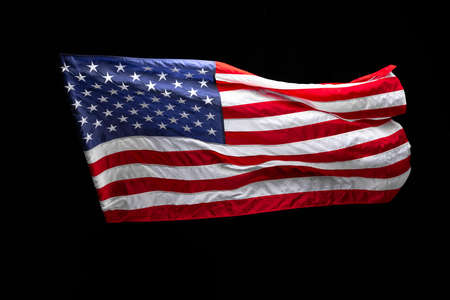 Flag of the USA isolated over dark black background. Memorial Day, Labour Day, Independence Day public holidays.