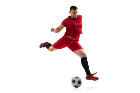 Powerful, flying above the field. Young football, soccer player in action, motion isolated on white background .