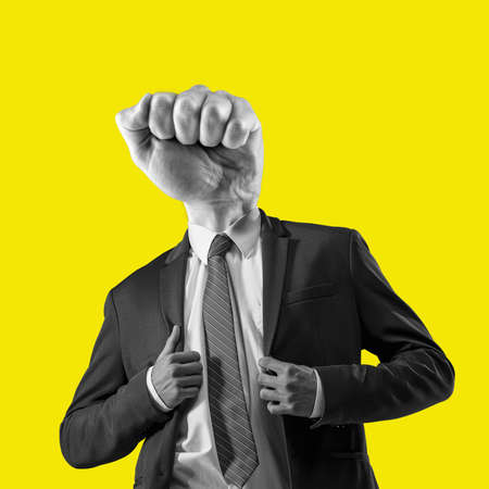 The man in a suit with a head in the form of a fist. Metaphor of an angry boss. Contemporary art collage