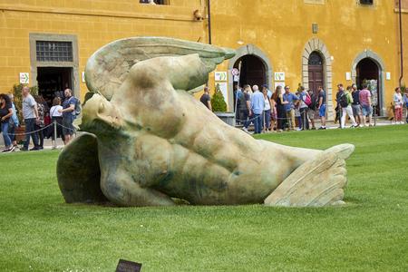 Pisa / Tuscany / Italy / May 2018 : Tourists Admire the Fallen Angel Statue by Igor Mitoraj Editorial
