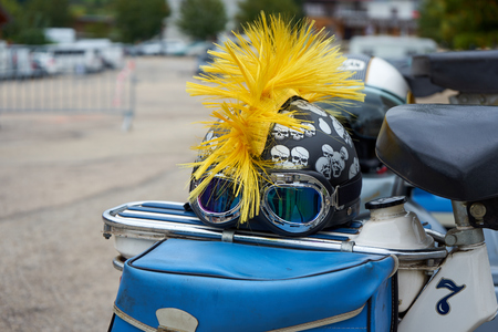 Metabief/Franche Comté/France/September 2018 : A Whimsical Helmet Sits On A Luggage Carrier Of A Moped