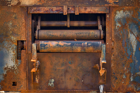 Burned Down And Rusty Industrial Machine Under Heavy Sunlight