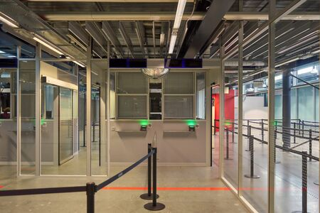 Empty Airport Border Police Counter With Ropes Signaling the Direction Stok Fotoğraf