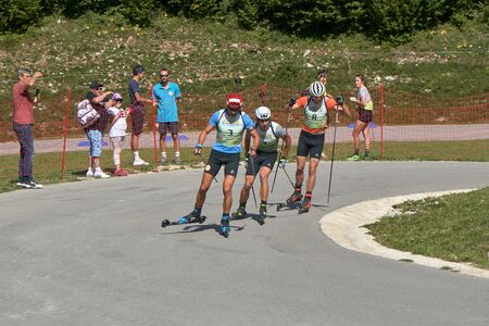Premanon Stade Des Tuffes - Bourgogne Franche Comté France - September 2019 - Simon Desthieux Leads The Chasing Group With Quentin Fillon Maillet And Emilien Jacquelin After Disqualification This Group Formed The Podium Of The Day Race