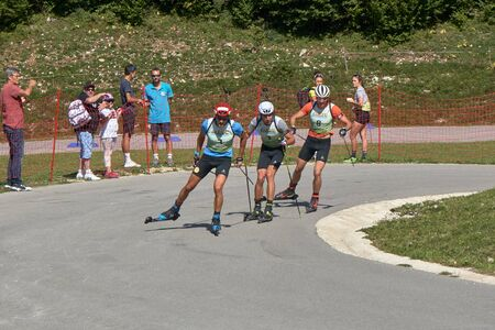 Premanon Stade Des Tuffes - Bourgogne Franche Comté France - September 2019 - Simon Desthieux Leads The Chasing Group With Quentin Fillon Maillet And Emilien Jacquelin After Disqualification This Group Formed The Podium Of The Day Race Редакционное