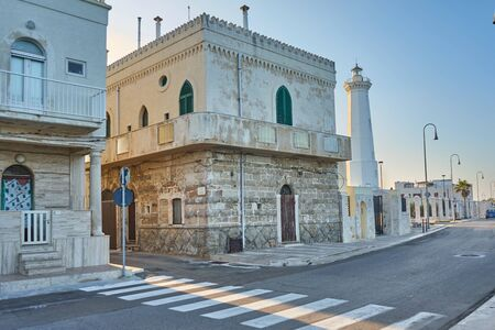 Typical Housing Of The Puglia Region And White Lightouse At Torre Canne Puglia Italy