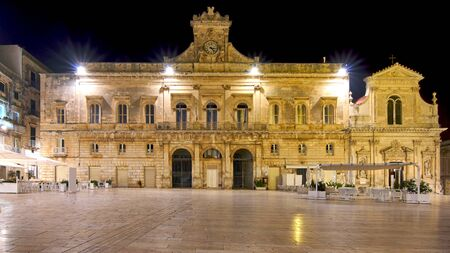 City Hall And And Empty Piazza De La Liberta (Main Square) Shot During The Night At Ostuni Puglia Italy