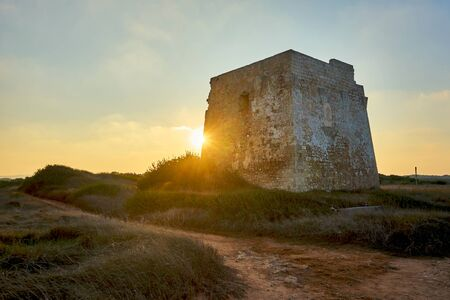 Ruins of Torre Pozzelle An Antique Coastal Watchtower In a Colourful Sunset Ostuni Puglia Italy.
