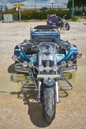 Pontarlier - Bourgogne Franche Comté France - June 16th 2019 - The Sun Shines On A Blue And Chrome Nicely Decorated Trike At Local Car Rallye. Редакционное