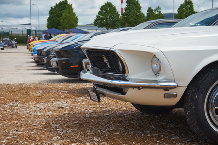 Pontarlier - Bourgogne Franche Comté France - June 16th 2019 - Line Of Various Colours Ford Mustang Park At a Local Car Rallye. Редакционное