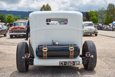 Pontarlier - Bourgogne Franche Comté France - June 16th 2019 - White 1930 Model A Ford Hot Rod Parks At A Local Car Rallye Rear View.