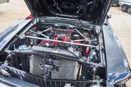 Pontarlier - Bourgogne Franche Comté France - June 16th 2019 - The Hood Of A Black Ford Mustang 351 Mach 1 Sits Open On A Local Car Rallye.