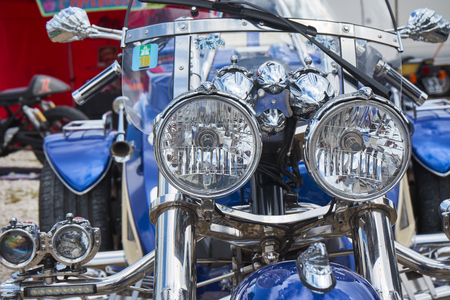 Pontarlier - Bourgogne Franche Comté France - June 16th 2019 - The Sun Shines Over A Head Light On A Blue And Chrome Trike At Local Car Rallye.