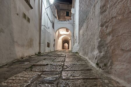 Old Streets Of Picturesque Old Town At Night Ostuni Puglia Italy. Фото со стока