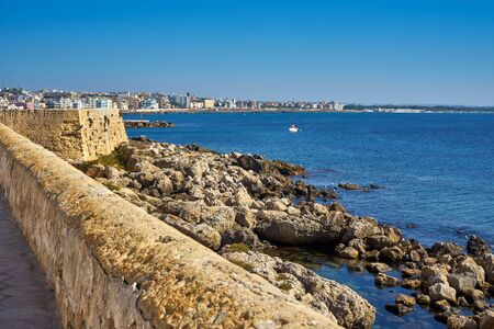 Coastline Cityscape With Colorful Houses During A Bright Atumn Day at Gallipoli Puglia Italy
