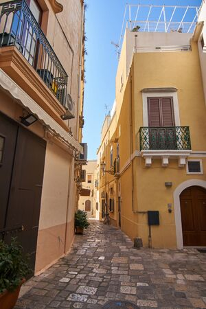 Typical Streets Of Old City Gallipoli In Puglia Italy During a Bright Sunny Day