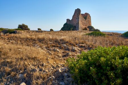 Torre Uluzzo in the Regional Park of Porto Selvaggio in Apulia At Sunset - Italy